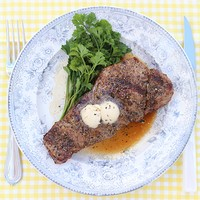 Pepper Crusted Steaks with Black Truffle Butter